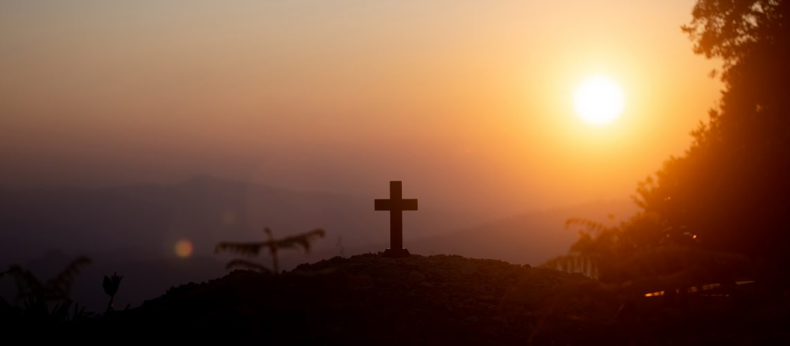 Resurrection concept:Crucifixion Of Jesus Christ Cross At Sunset